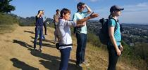 Nell Green Nylen (right) and her colleagues stop for a view of San Francisco Bay on a hike in the East Bay Hills above the UC Berkeley campus. Photo by Lidia Cano Pecharromán. for The Confluence Blog