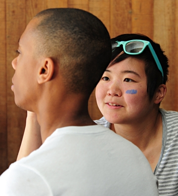 Ivana Li works on a face-painting.