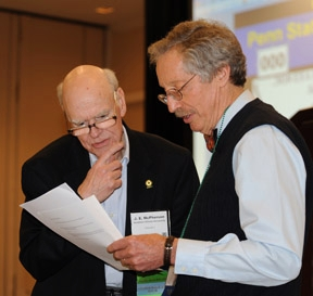 Emcee Tom Turpin (right) of Purdue University confers with judge J. E. McPherson of Southern Illinois University.