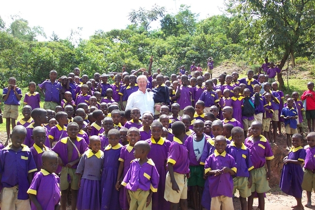 Thomas Scott with schoolchildren in Kenya in 2004. He was there to study malaria. Almost half of the children in this photo had malaria at the time. (Photo courtesy of the Thomas Scott lab)