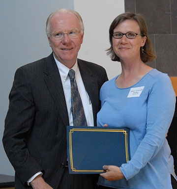 Chancellor Larry Vanderhoef and Fran Keller with her outstanding graduate student teaching award.