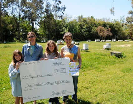 Sheridan Miller (second from right) presents a check to Lynn Kimsey (far right), professor and chair of the UC Davis Department of Entomology and director of the Bohart Museum of Entomology. From left are Annelie Miller, 8, Sheridan's sister who helped with the fundraising; bee breeder-geneticist Susan Cobey; Sheridan Miller, 11; and Lynn Kimsey.
