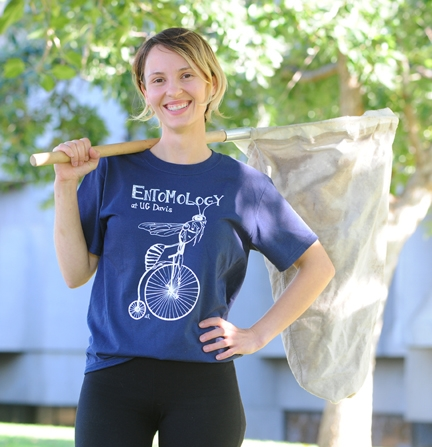 Stacey Rice with her prize-winning t-shirt of a wasp riding a penny-farthing. (Photo by Kathy Keatley Garvey)