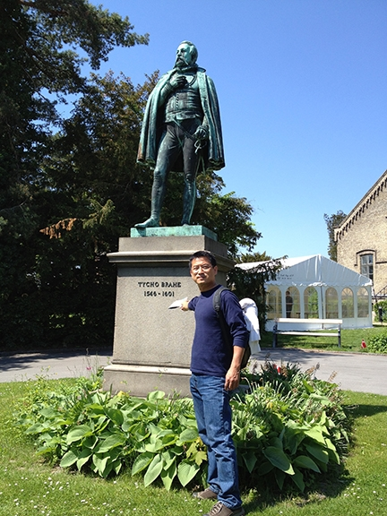 Shih-Wen Young co-juried the show. He is shown here in the Botanist Gardens, Copenhagen, Denmark.