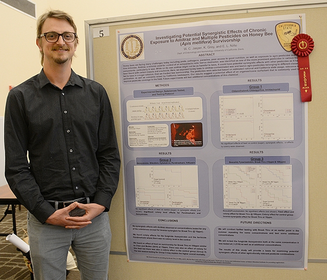 Second-place winner W. Cameron Jasper of UC Davis with his poster on pesticide exposure. (Photo by Kathy Keatley Garvey)