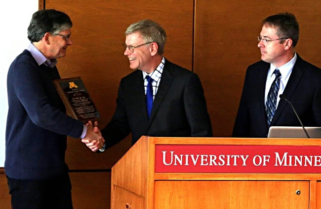 Professor Ralph Holzenthal (left), director of the University of Minnesota Insect Museum, congratulates  Professor Karl Kjer (center) on receiving the Hodson Alumni Award. At right is Stephen Kells, chair of the University of Minnesota Department of Entomology.