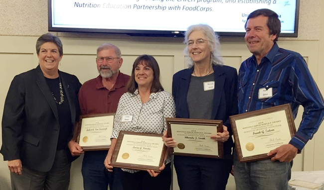 UC ANR Vice President Glenda Humiston (far left) presents the UC ANR Outstanding Team Award to the European Grapevine Moth Team. From left are Robert Van Steenwyk, Lucia Varela, Rhonda Smith and Frank Zalom. (UC ANR Photo)
