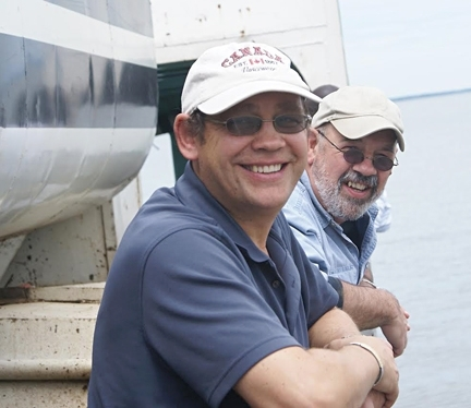 Medical entomologists Anthony Cornel (foreground) and Greg Lanzaro study malaria mosquitoes and are co-authors of a study published Sept. 15 in PLOS Genetics.