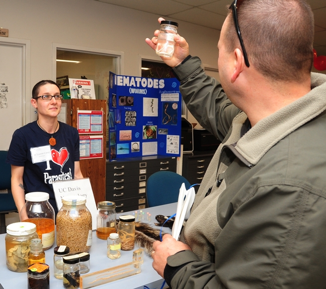 Nematologist/parasitologist Lauren Camp talks to a visitor at the Bohart Museum's Parasite Palooza open house on Sunday, Jan. 21. (Photo by Kathy Keatley Garvey)