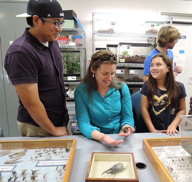 Visitors at the 2016 TODS Day at the Bohart Museum of Entomology included Kaori Catalan, then 9, daughter of UC Davis employees Eric and Gaylene Catalan. Eric works in registrar's office and Gaylene in nutrition. In back is graduate student Ziad Khouri. (Photo by Kathy Keatley Garvey)