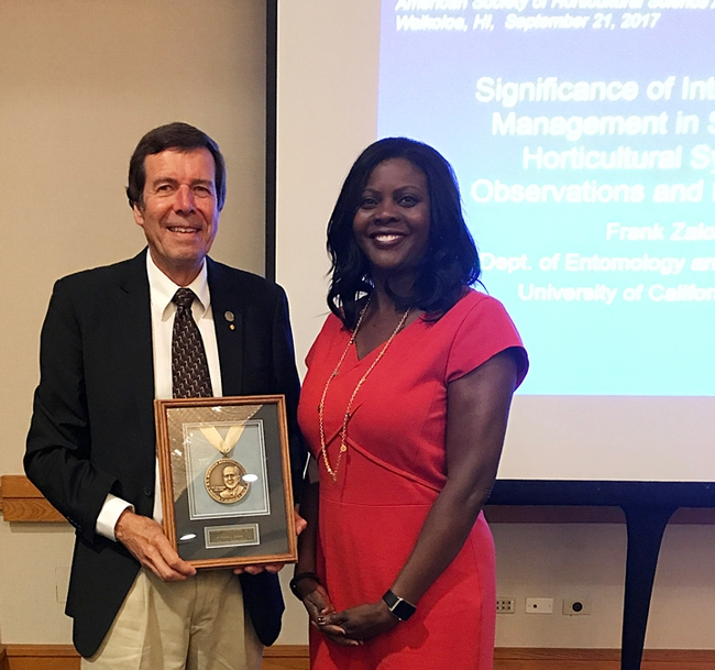 UC Davis distinguished professor Frank Zalom receives the 2017 B. Y. Morrison Medal from Chavonda Jacobs-Young, the USDA-ARS administrator, at a ceremony in Waikoloa, Hawaii.