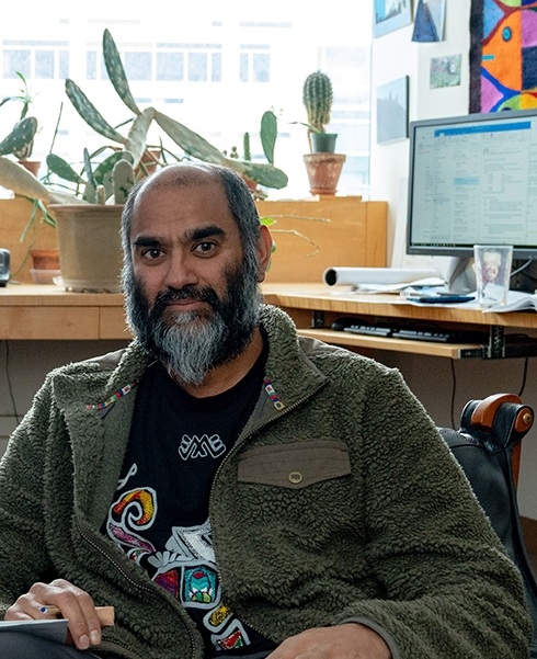 Professor Anurag Agrawal in his office at Cornell University. (Photo by David Burbank)