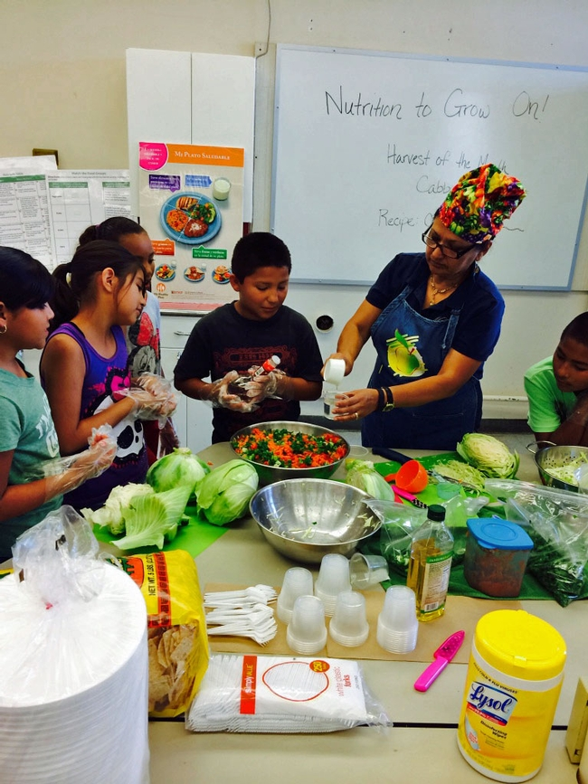 UC nutrition educator Grilda Gomez prepares coleslaw with Pixley Elementary third-graders.