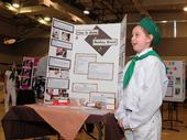 Second-year 4-H'er Maya Farris, 9, of Vacaville, answers questions about her monkey bread display at the Solano County 4-H Presentation Day. (Photo by Kathy Keatley Garvey)