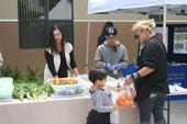 A mini farm stand in front of Vang Pao Elementary School in Fresno offers farm-fresh produce to children and families.