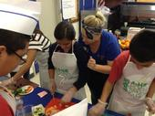 Students practice culinary skills.