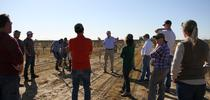 Kevin Day, center, discusses tree development with course participants in a young orchard. for Food Blog Blog