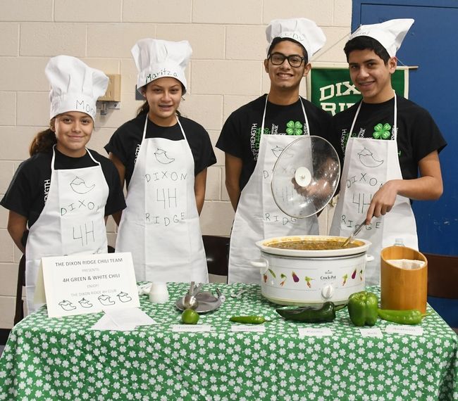 "This is the championship Dixon Ridge 4-H Club Chili Team: (from left)  siblings Moncerral ""Monce"" Torres Cisneros, Maritzia Partida Cisneros, Rudolfo ""Rudy"" Radillio Cisneros, and Miguel Partida Cisneros. They made ""4-H Green and White Chili."" (Photo by Kathy Keatley Garvey)"