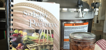 So Easy to Preserve recipe book, pressure canner, and finished jar of canned pinto beans for Food Blog Blog