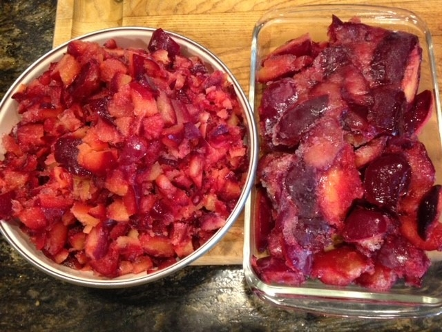 Container of chopped frozen plums and container of frozen plum halves