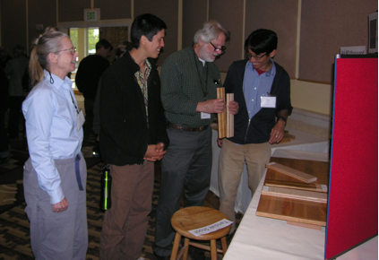 Conference participants examining tanoak samples