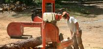 Rob York with portable saw mill for Forest Research and Outreach Blog