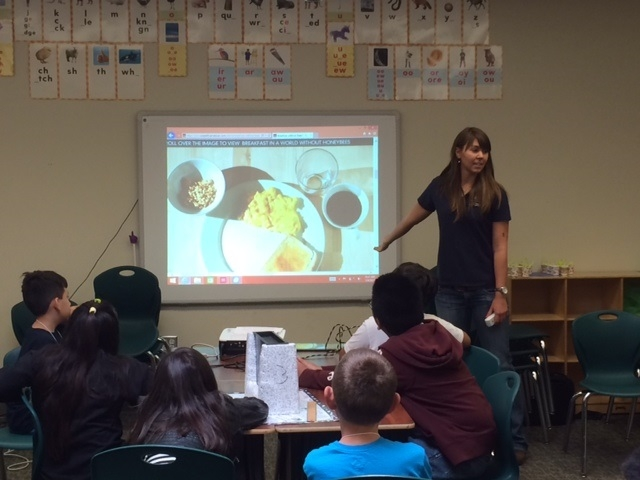 Valerie Grant,YFC Education Specialist II, shows campers a breakfast in a world without honeybees
