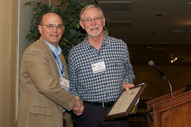 AAIE president Pete Goodell (left) presented Walt Bentley (right) the Lifetime Achievement Award.