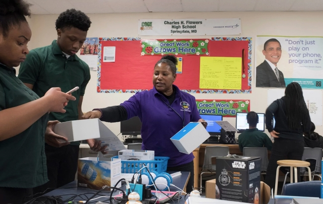 Teacher Marilyn Fitzpatrick gives guidance to 10th-graders Stephanie Okoro and Reginald Bryant in her AP Computer Science Principles course at Flowers High. (Marvin Joseph/The Washington Post)