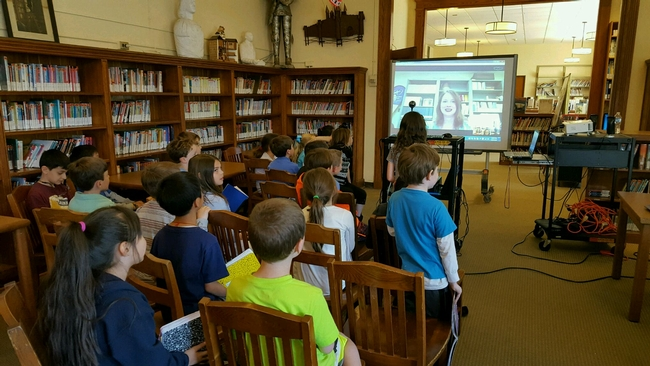 Students congregated in the school library video conference with Elizabeth Fichtner.