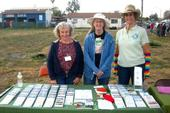 Corona area gold miner Cindy Peterson and volunteers at an area event