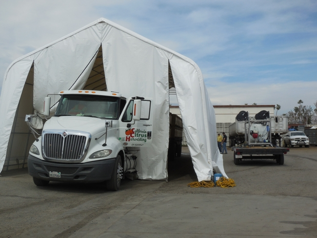 Semi-truck leaves the load in the portable fumigant tent