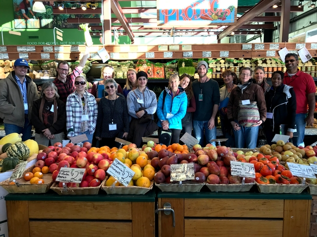 Local farmers tour Sebastopol's Community Market during a UCCE Tour to Meet Buyers in December