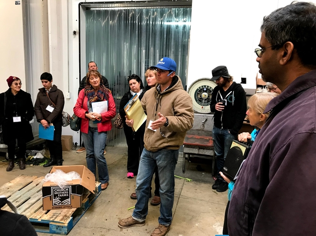 Local farmers hear from a distributor about how to get into the wholesale market during a UCCE Tour to Meet Buyers in December