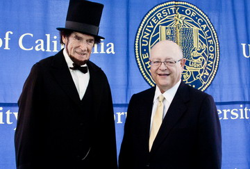 UC President Mark Yudof with Lincoln as portrayed by actor, celebration passage of the Morrill Act.