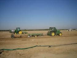 Fumigant injection and soil disking and rolling in a fumigation trial. Photo by Suduan Gao