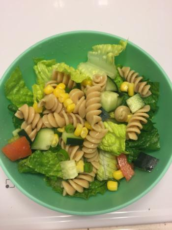 Romain lettuce topped with 1/2 cup pasta salad.