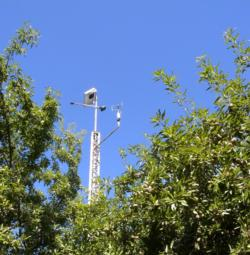 Eddy covariance system for ETc measurement Sonic installed in a tower at experimental site. Kern Co.