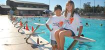 SANA KOBAYASHI, 13, left, and Maddie Schreck, 12, swim buddies on the AquaSol swim team, pose for a photo at the Western Slope Aquatic Center. Democrat photo by Krysten Kellum. for 4-H in the Media Blog