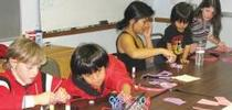 Cloverbuds are 4-H members in kindergarten through third grade. They are pictured, from left, Pavel, Jonah, Jonah's mom and brother and Trinity making Valentine cards for the senior center, for 4-H in the Media Blog