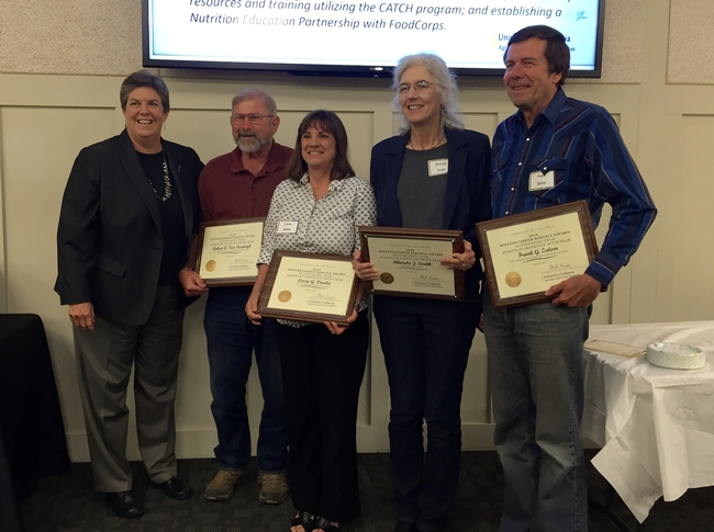Humiston presented the team award to, from left, Bob Van Steenwyk,  Lucia Varela, Rhonda Smith and Frank Zalom on behalf of the European Grapevine Moth team.