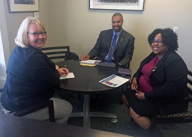 UC Associate Vice President Wendy Powers, left, consults with the Staff Advisor-designate, Jason Valdry, and Staff Advisor, LaWana Richmond.