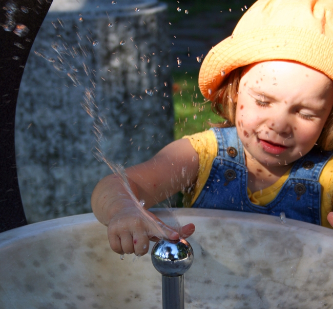Child Drinking Fountain Water