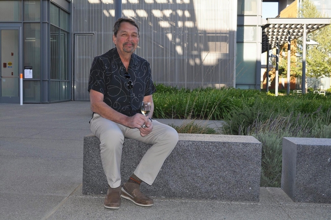 Jim Wolpert sits on bench dedicated to him by V&E faculty in April 2015.