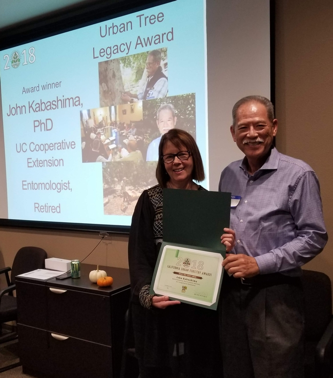 John Kabashima, right, receives urban tree award.