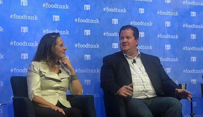 Sarah Mesnick of Scripps Institution of Oceanography at UC San Diego, left, and Gabe Youtsey discuss the role of technology in the food movement at the Food Tank Summit in San Diego.