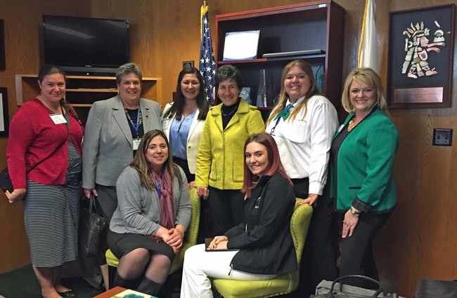 Assemblymember Susan Talamantes Eggman poses with UC ANR members in her office.