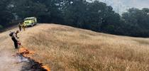 A Mendocino County Fire Safe Council member sets a prescribed burn during a UC ANR fire retreat. Photo by Lenya Quinn-Davidson for ANR Employee News Blog