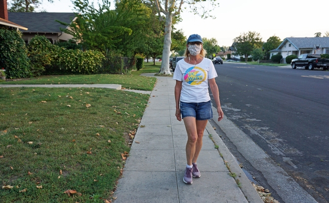 Jeannette Warnert walks wearing a homemade face mask. UC Walks is May 6. Post your UC Walks photos on social media with #UCANRmoves and #ucwalks.