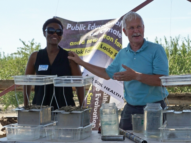 Jeff Mitchell, right, and Esther Mosase, UCCE climate-smart educator, demonstrate soil health at a 2019 field day.